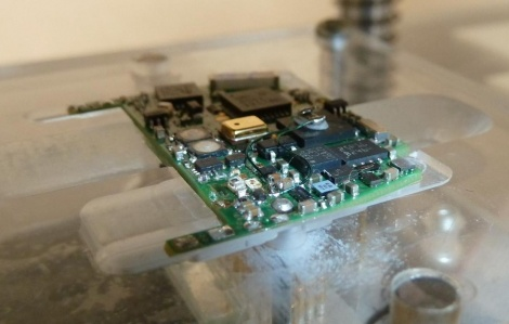 Prototype product PCB (Device Under Test) in the test jig.