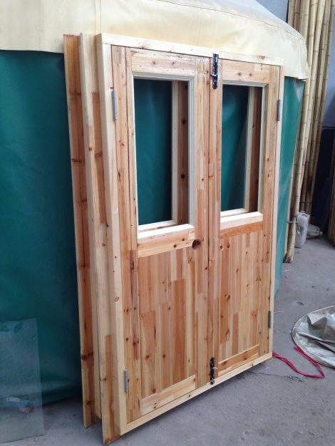 wooden door with glass windows