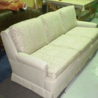 JARO's Kirwin Sofa with beautiful scolloped back and scrolled arms.