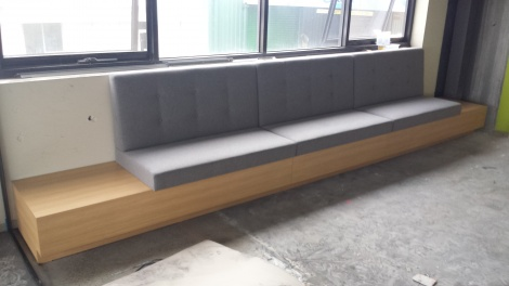 Banquette Seat with Timber look Tables on each End.