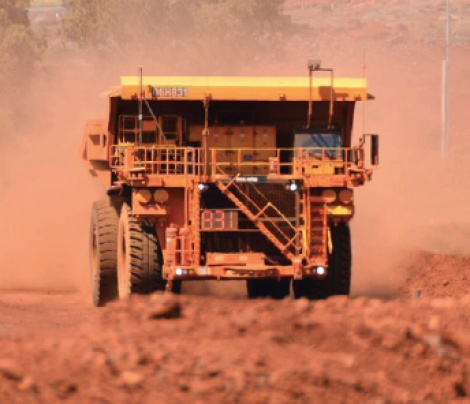 Driverless trucks move all iron ore at Rio Tinto's Pilbara mines, in world first