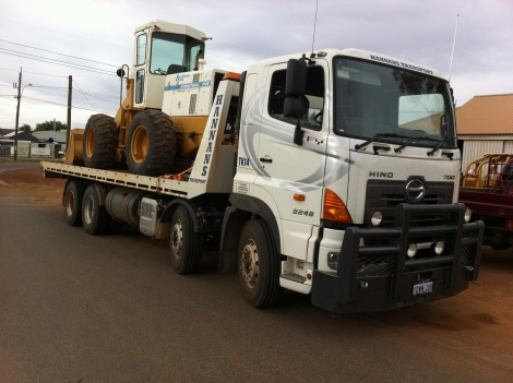 Moving a loader to site...