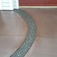 Coloured Driveway with Exposed Aggregate Detailing