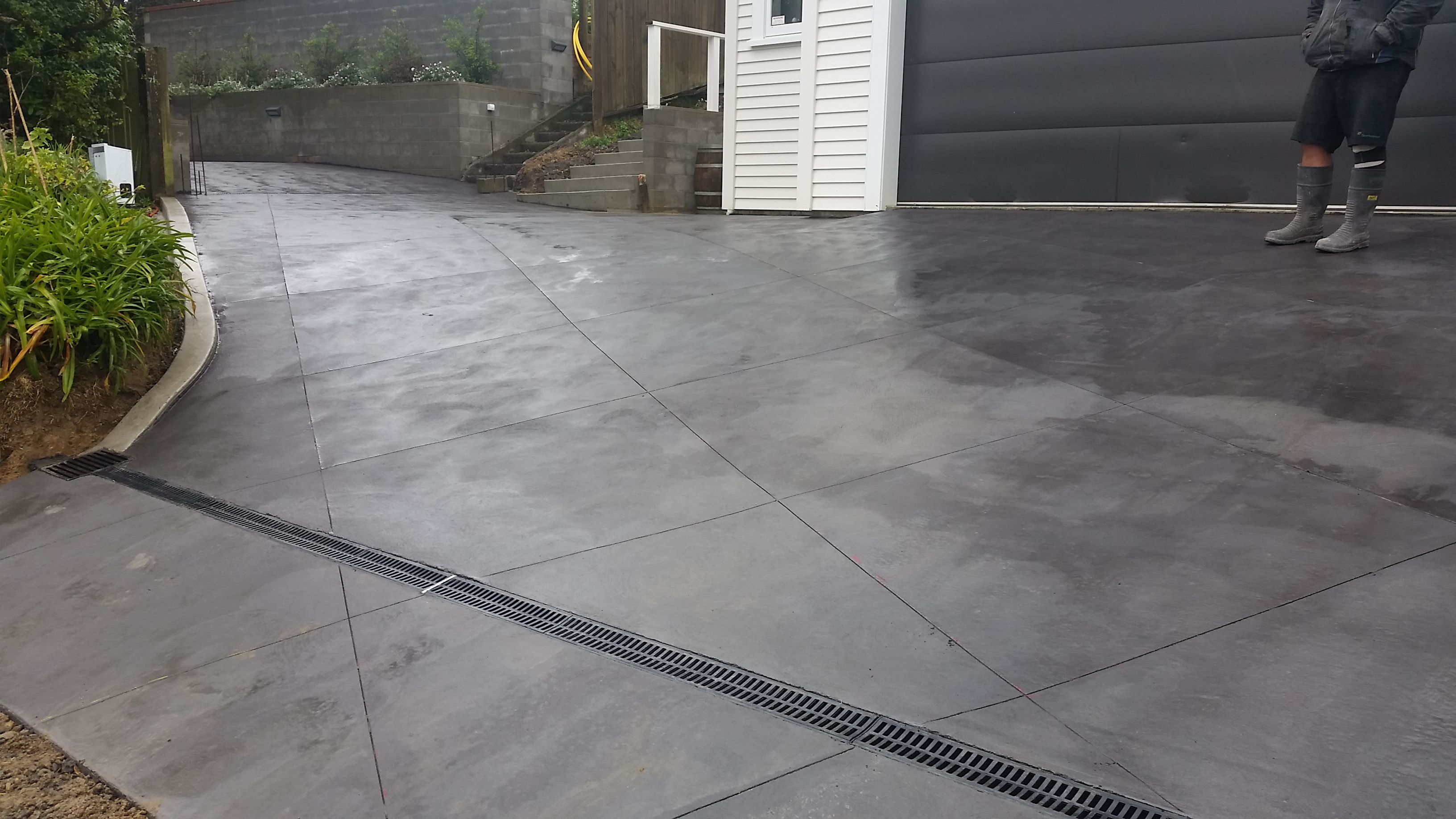 Texture trowel finish with 1 4m grid cuts - RGS Concrete