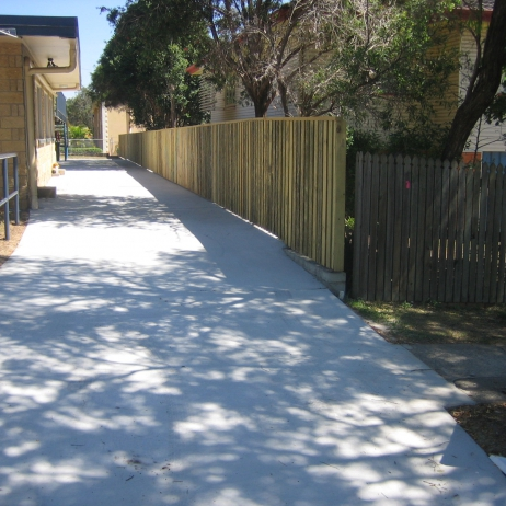 Plain concrete Driveway & built a block Retaining Wall with timber Fence on top.