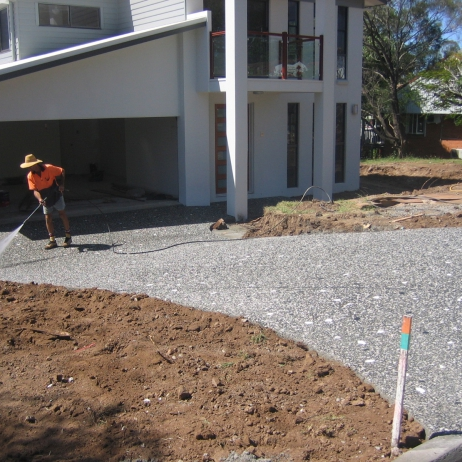 Exposed checkerboard mix Driveway with white Quartz added by hand during concrete pour.
