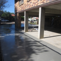 Plain concrete Driveway Extension onto existing undercover Carpark with Everhard Drainage installed.