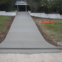 Plain concrete Driveway with Grid Crossover.