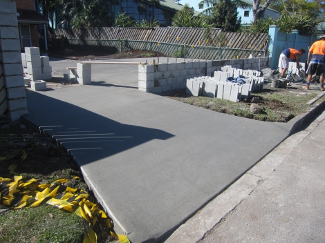 Plain concrete Driveway and Carport with a broom finish including Block Fence built for rendering.