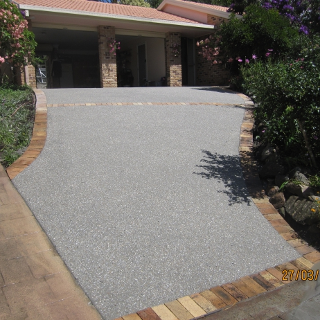 AFTER PHOTO -New Exposed brown & white mix Driveway using old pavers for edges & control joints.