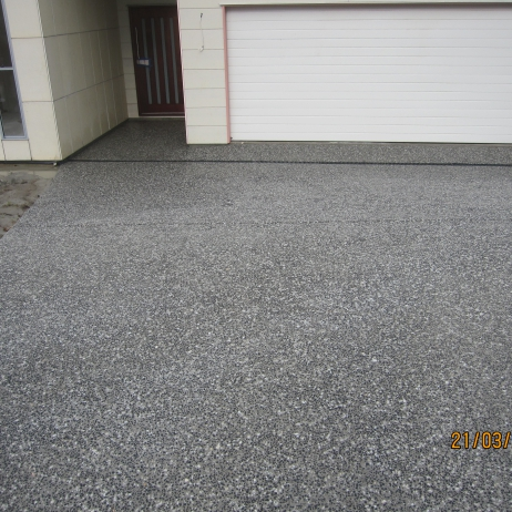 AFTER PHOTO - New Eclipse exposed mix Driveway with Everhards Drains.