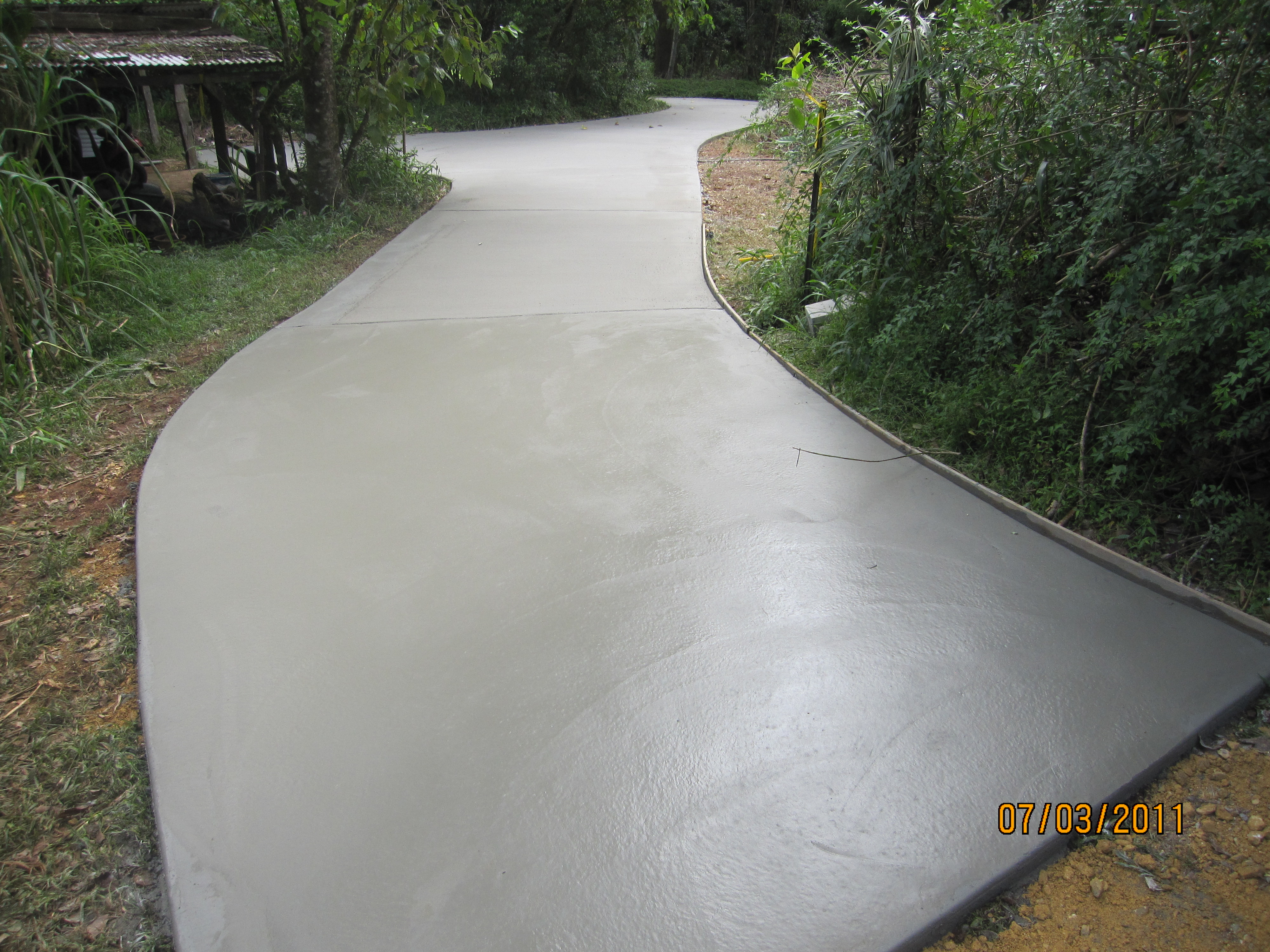 After photo new plain concrete driveway instead of road for Base for concrete driveway