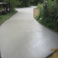 AFTER PHOTO - New plain grey concrete Driveway instead of Road Base Driveway.