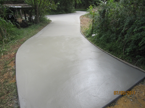 AFTER PHOTO - New plain concrete Driveway instead of Road Base Driveway.