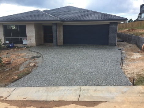 AFTER PHOTO:  New exposed Driveway with Everhard Drains & Path to front entrance of new house build.