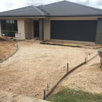 BEFORE PHOTO:  Prepare Driveway with Everhard Drains & Path to front entrance of new house build.