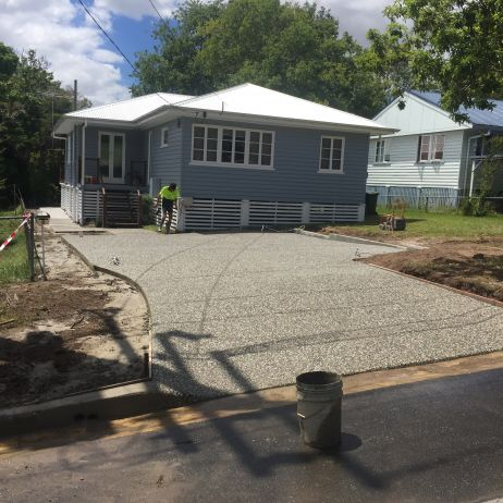 AFTER PHOTO: New Eclipse exposed future Carport Slab, Path & Driveway with Swale Crossing