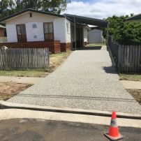 AFTER PHOTO:  New Eclipse Exposed Carport Slab & Driveway with Grid Crossover.