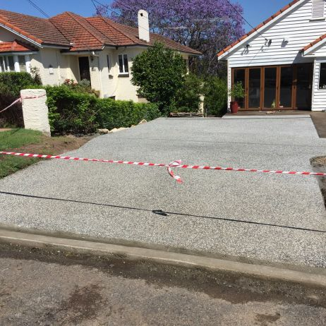 AFTER PHOTO:  New Eclipse Exposed future Carport Slab & Driveway with Grid Crossing.
