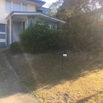 BEFORE PHOTO:  Replace existing driveway with new driveway & block retaining fence.