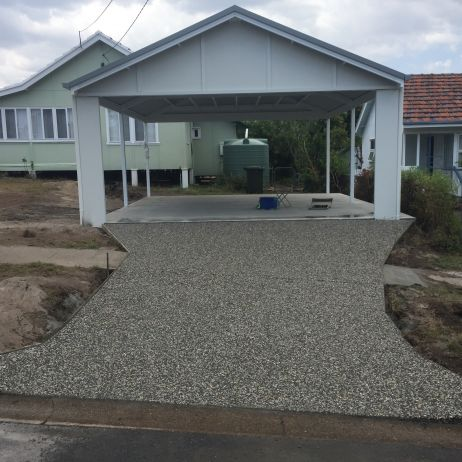 Carport Slab in plain concrete & Driveway with Swale crossing in eclipse exposed mix.