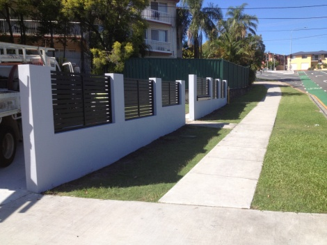Constructed Besser Block Rendered Front Fence with black Aluminium Inserts & letterbox bank.