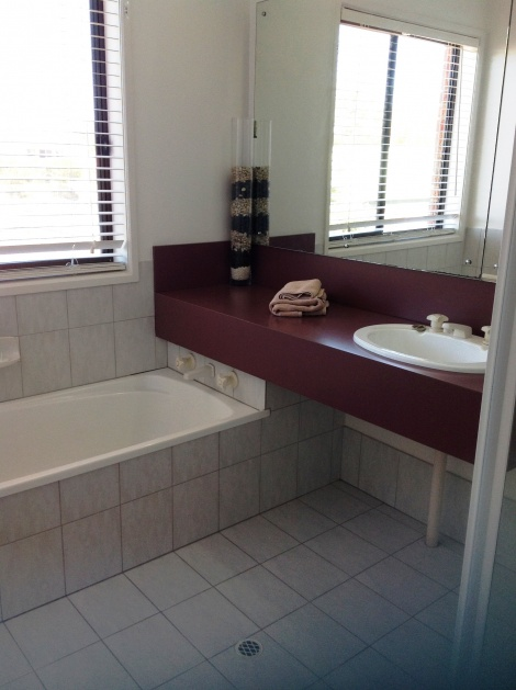 All Seasons Lakefront Getaway 2nd bathroom with bath & shower