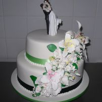 2 tier wedding cake with assorted flowers