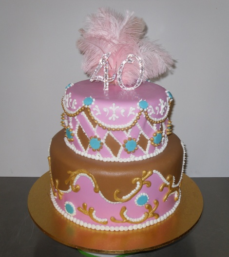 Two tier pink and caramel cake