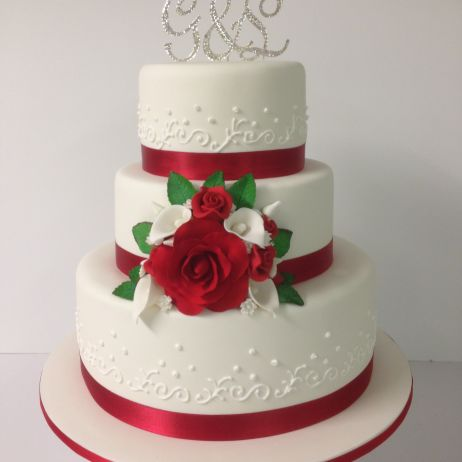 3 tier red and white wedding cake