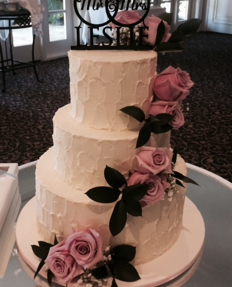 Rough buttericed wedding cake