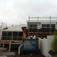The scaffolding is going up for shrink-wrap: Step One