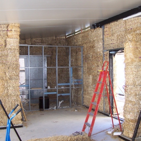 Loadbearing Strawbale walls. Note: Bales were laid upright to reduce wall thickness