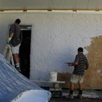 Final coat, limeputty render on strawbale walls
