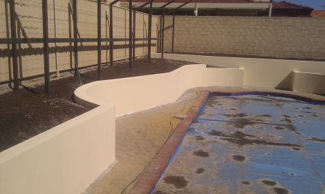 Brick retaining walls with sandfinish render . Topcoated with Acrashield  der