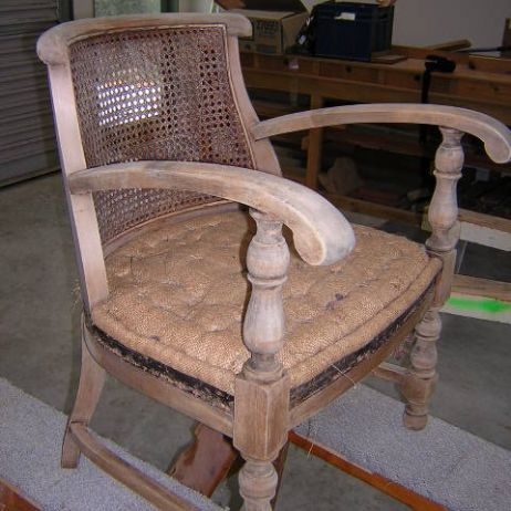 Cane filled armchair-before