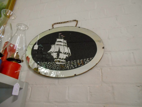 Oval mirror with sailing ship