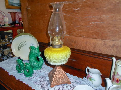 Yellow glass oil lamp with kingfisher base