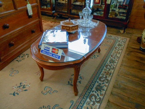 Coffee table with protective glass top