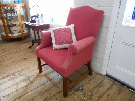 Large upholstered chair with arms