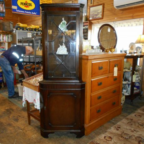 Tall mahogany corner display cabinet