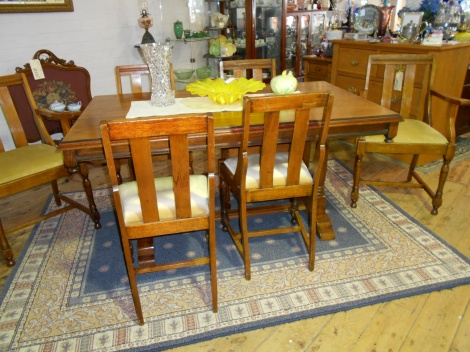 Light oak table with matching chairs