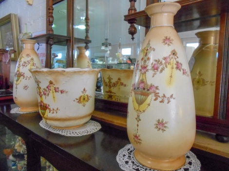 Antique jardiniere with matching vases