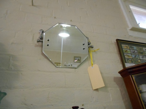 Unusual tilting vanity mirror with fish shape brackets