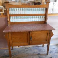 Pine washstand with red granite top and tiled back