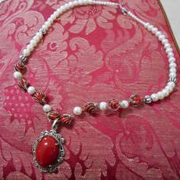 Coral pendant set in sterling silver