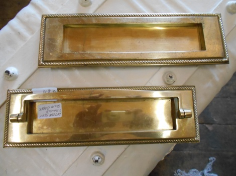Old brass letter box slots for a front door