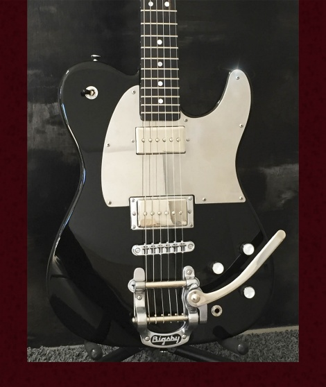 A superb Tele from California, Peter's custom black Telecaster with the new Jim Root HH Super Mirror