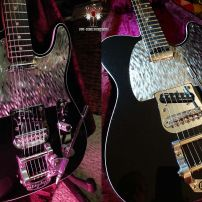 A sleek, black Fender Tele, Elite series with Silver Nova guard Telecaster Roller Bridge and Bigsby