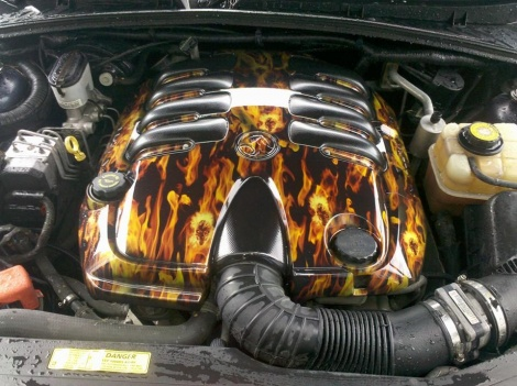 Engine cover in skull flames